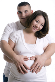 Young Pregnant Couple wearing white shirts