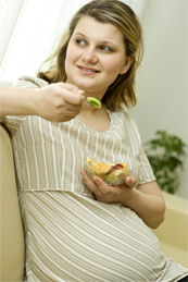 Pregnant lady eating fruit