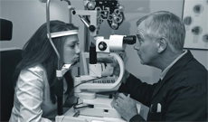 Girl having eye test